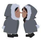 Eskimo couple. Image of an eskimo couple kissing eskimo style Royalty Free Stock Photo