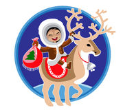 Eskimo girl and reindeer Stock Images