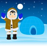 Eskimo beside igloo Stock Photo