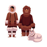 Eskimo, Inuit couple in warm winter clothes with sledge dog Royalty Free Stock Image