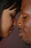 Eskimo Kiss. Asian female and African American male doing the Eskimo kiss Stock Photography