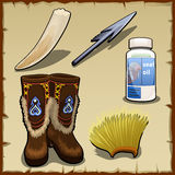 Eskimo set of tusk, harpoon, hat and seal fat Stock Images