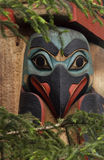 Eskimo totem pole bird. Painted bird face on an Eskimo totem pole in Alaska Stock Photography