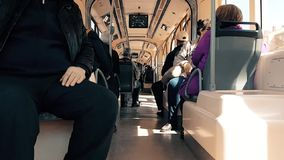 Passengers sitting in tram at day time. Eskisehir, Turkey - April 03, 2017: Interior of a tramway in motion, with people and sunlight stock footage