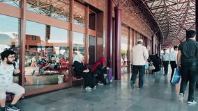 Passengers waiting the bus at Eskisehir Bus Terminal on a sunny day stock video footage