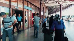 Passengers waiting the bus at Eskisehir Bus Terminal on a sunny day. Eskisehir, Turkey - August 13, 2018: Unidentified people waiting the bus at Eskisehir Bus stock footage