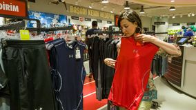 Eskisehir, Turkey - August 11, 2017: Young woman looking at a sports clothing in a sports shop in Eskisehir. Stock Photo