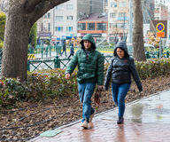 Eskisehir, Turkey - March 13, 2017: Couple walking in the street. On a rainy day Royalty Free Stock Photography