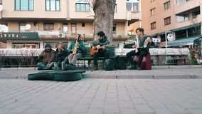 Street musicians celebrating Canakkale Victory and Martyr's Day in the street. Eskisehir, Turkey - March 18, 2017: Front view of street musicians playing Turkish stock footage