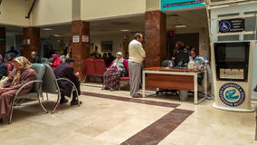 Eskisehir, Turkey - March 28, 2017: People waiting for a doctor. Eskisehir, Turkey - March 28, 2017: People waiting for doctor in hospital lobby. Man waiting stock image