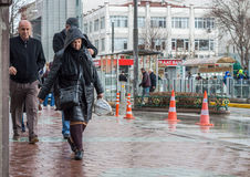 Eskisehir, Turkey - March 13, 2017: People walking in the street. At the center of the city on a rainy day Royalty Free Stock Image