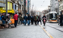 Eskisehir, Turkey - March 13, 2017: People walking in the street. At the center of the city while a tramway passing Royalty Free Stock Photo