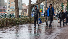 Eskisehir, Turkey - March 13, 2017: People walking in the street. On a rainy day Stock Images