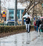 Eskisehir, Turkey - March 13, 2017: People walking in the street. On a rainy day Royalty Free Stock Photo