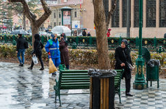 Eskisehir, Turkey - March 13, 2017: People walking in the street. On a rainy day Stock Photos