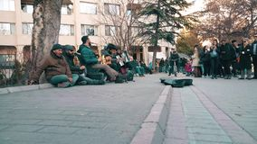 Street musicians celebrating Canakkale Victory and Martyr's Day in the street. Eskisehir, Turkey - March 18, 2017: Street musicians playing the song Arkadasim stock footage