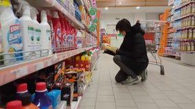 Eskisehir, Turkey - March 15, 2017: Young woman shopping in supermarket. Eskisehir, Turkey - March 15, 2017: Young brunette woman shopping in supermarket stock video