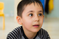 Eskisehir, Turkey - May 05, 2017: Preschool little boy looking curiously in a classroom. Eskisehir, Turkey - May 05, 2017: Preschool kids attending to an animal royalty free stock images