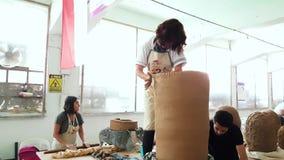 Artist woman working on her sculpture at the 12th International Eskisehir Terra Cotta Symposium. Eskisehir, Turkey - September 04, 2018: Female artist working at stock video footage