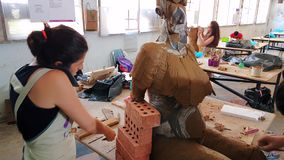 Artist woman working on her sculpture at the 12th International Eskisehir Terra Cotta Symposium. Eskisehir, Turkey - September 04, 2018: Female artist working at stock footage