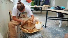 Pottery artist making clay pot at the 12th International Eskisehir Terra Cotta Symposium. Eskisehir, Turkey - September 04, 2018: Pottery artist making clay pot stock footage