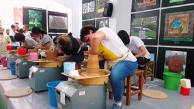 Students attending to the pottery contest at the 12th International Eskisehir Terra Cotta Symposium stock footage
