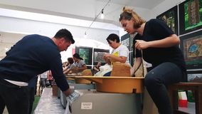 Students attending to the pottery contest at the 12th International Eskisehir Terra Cotta Symposium. Eskisehir, Turkey - September 08, 2018: Students preparing stock video footage