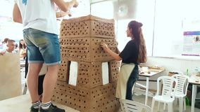 Two young students working on a sculpture at the 12th International Eskisehir Terra Cotta Symposium. Eskisehir, Turkey - September 04, 2018: Two young Caucasian stock video footage