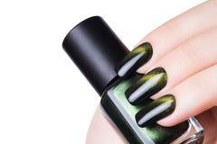 Esmalte de uñas verde fotografía de archivo