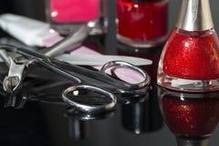 Esmaltes de uñas y accesorios para la manicura Foto de archivo libre de regalías