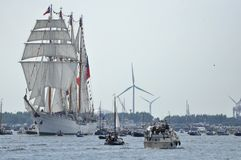 The Esmeralda tall ship on the Ij river. Ij River, Amsterdam, the Netherlands - August 19, 2015: Long distance view of the Esmeralda tall ship (Chile) among Royalty Free Stock Image