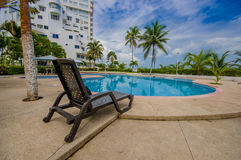Esmeraldas, Ecuador - March 16, 2016: Beautiful swimming pool with circle form, with a rattan chair in the border in a Royalty Free Stock Image