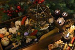 Esoetric and wicca still life with box of gifts, pentagram, candles and herbs on witch table. New Year and Christmas celebration greeting card and holiday stock image