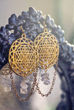 Esoteric earrings. With sacred geometry Stock Images