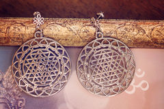 Esoteric earrings. With sacred geometry Royalty Free Stock Image