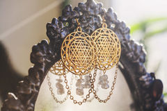 Esoteric earrings. With sacred geometry Royalty Free Stock Photos