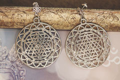 Esoteric earrings. With sacred geometry Stock Image