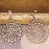 Esoteric earrings. With sacred geometry Stock Photos