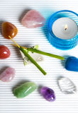 Esoteric stones. Esoteric wellness, reiky with healing stones in magic circle with stwo aroma sticks and a candle Royalty Free Stock Photo