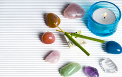 Esoteric stones. Esoteric healing stones in magic circle with a candle and aroma sticks and copy space Royalty Free Stock Photo