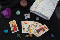 Esoteric table with astrological wheel, magic pendulum, tarots, stock illustration