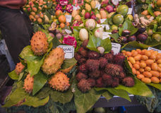 Esotic fruits at the market in boxes Stock Photos