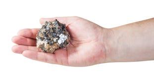 Espécime do minério mineral do zinco e da ligação na palma masculina fotografia de stock