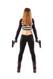 Espía de sexo femenino enigmático con los armas Imagen de archivo libre de regalías