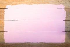Espaço cor-de-rosa da pintura no fundo de madeira Fotos de Stock