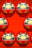 Espaço do texto de Lucky Daruma Dolls On Red Imagem de Stock