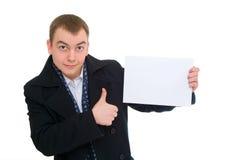 Espaço em branco vazio e polegar da preensão feliz do homem de negócios acima fotografia de stock