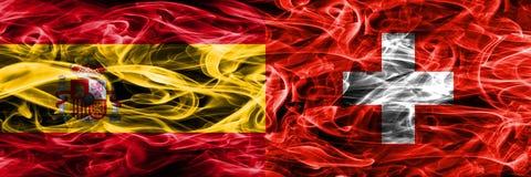 España contra las banderas del humo de Suiza colocadas de lado a lado Colo grueso Ilustración del Vector