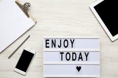Espace de travail avec le comprimé, smartphone, bloc-notes Photographie stock libre de droits