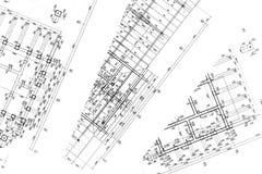 Espace de travail d'architectes avec des plans Photographie stock libre de droits